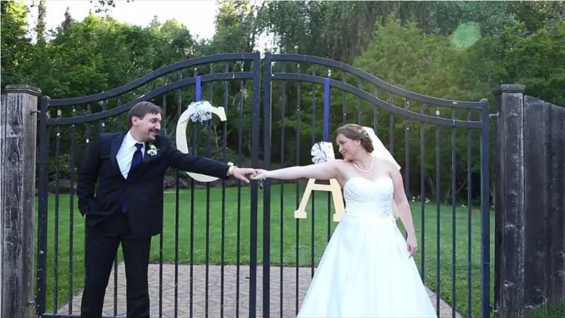 bride and groom standing in front of hanging monogram in Villa Chanticleer Wedding Film | Videographer: Baby Blue Film | via http://emmalinebride.com/real-weddings/villa-chanticleer-wedding-film-corey-anthony/