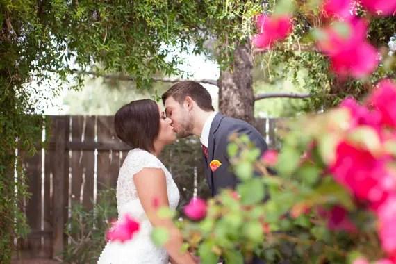 rustic chic arizona wedding bride and groom kissing at Shenandoah Mill