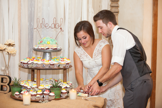 rustic chic DIY wedding at Shenandoah Mill cupcake table, bride and groom cutting