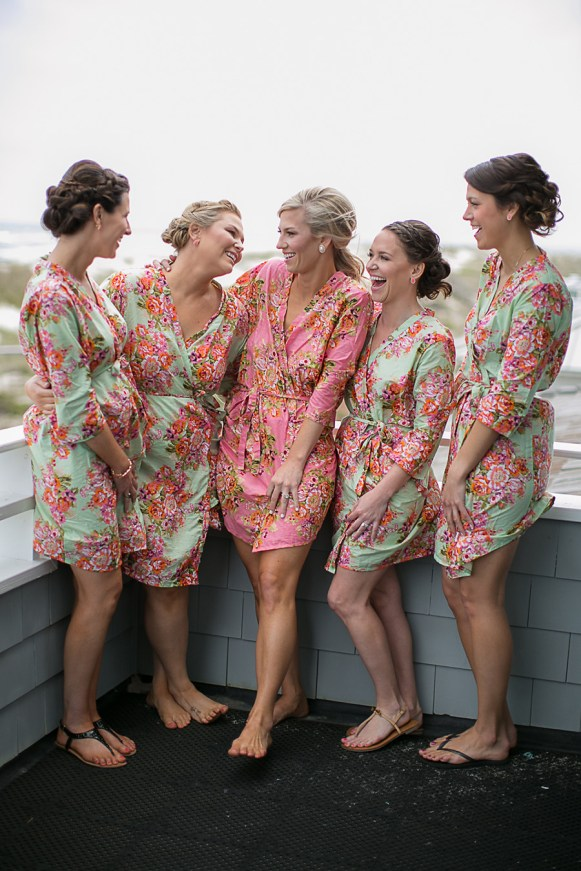 The Bride and Bridesmaids in Floral Robes Getting Ready - Bald Head Island Wedding - Photo by Eric Boneske
