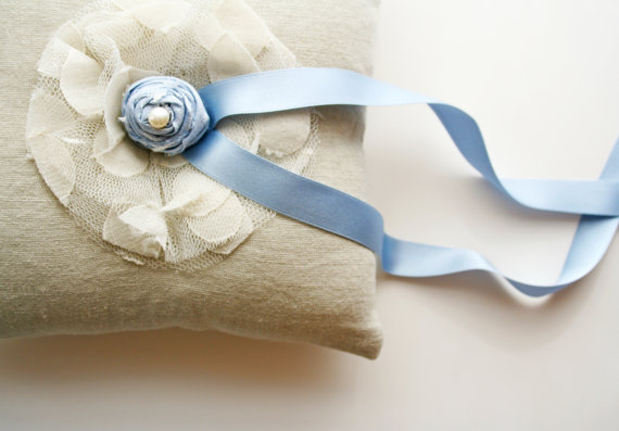 blue rosette ring pillow via 8 Chic Linen Ring Pillows