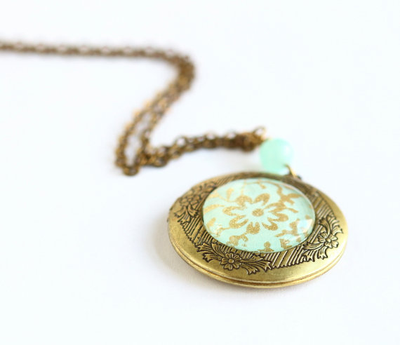 Wrap this handmade wedding locket around your bouquet as 'something blue'.  After the wedding, fill with your favorite photos and wear on your honeymoon.  By Jacaranda Designs.