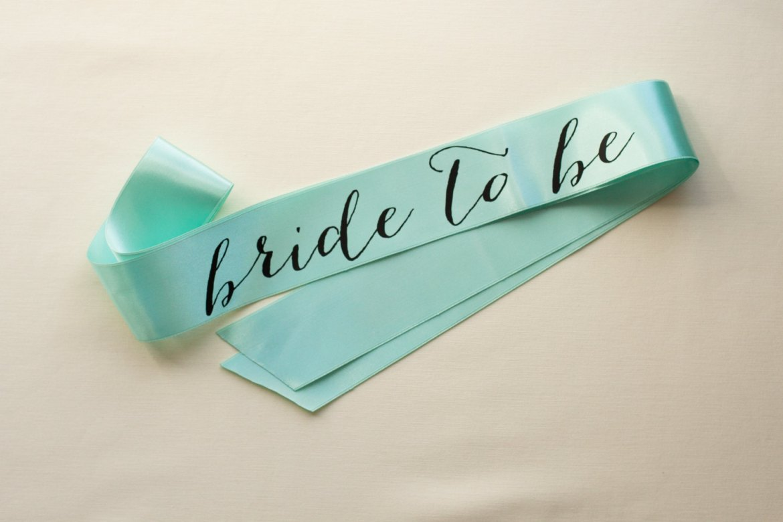 bride to be black on mint sash | stylish bachelorette sash ideas | via http://emmalinebride.com/bride/bachelorette-sash-ideas/