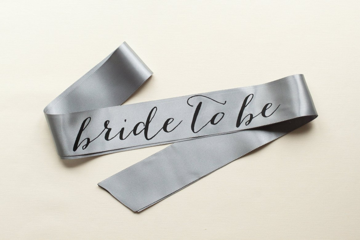 bride to be sash silver with black text | stylish bachelorette sash ideas | via http://emmalinebride.com/bride/bachelorette-sash-ideas/