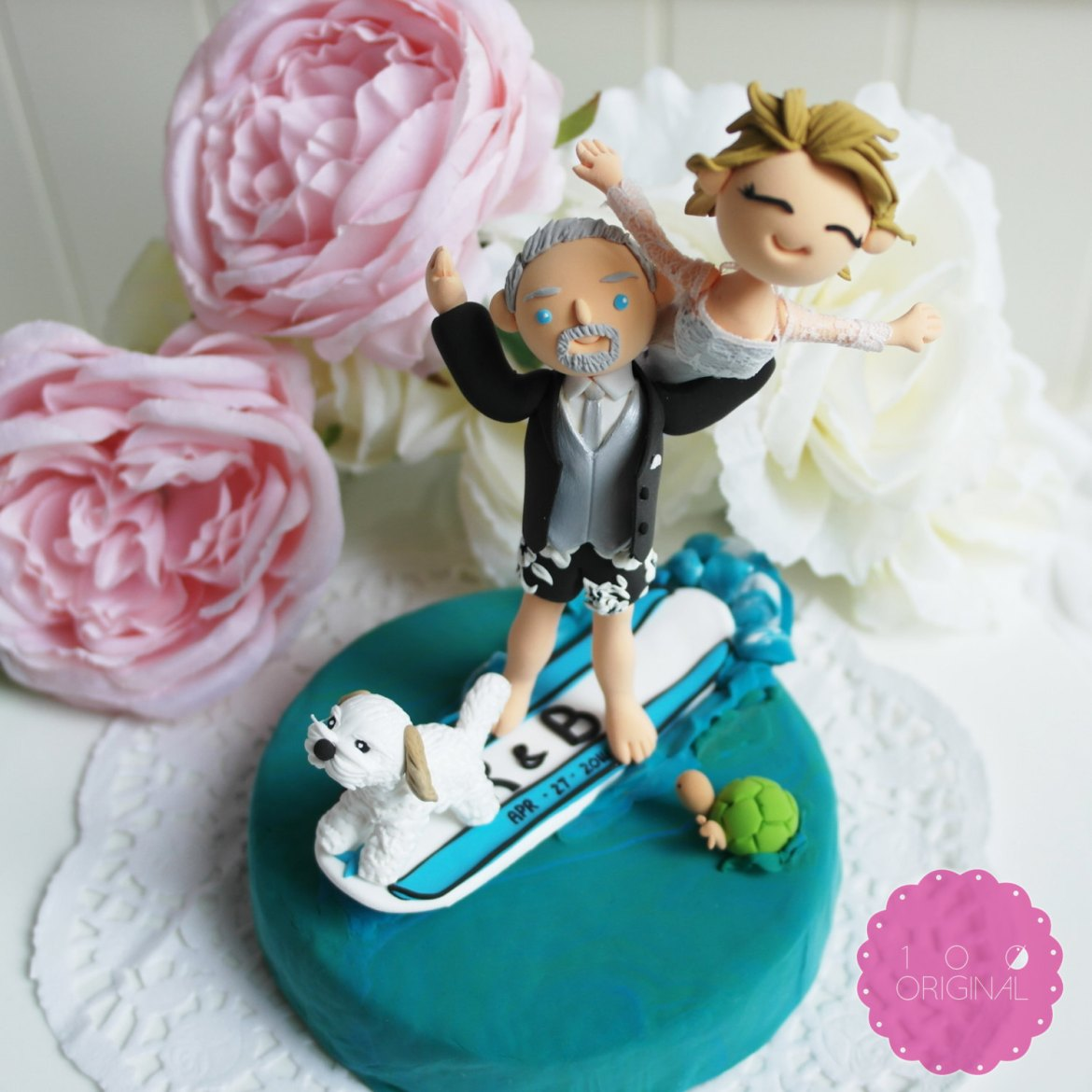 cake topper surfing bride and groom - 9 Adorable Custom Made Cake Toppers via http://emmalinebride.com/decor/custom-made-cake-toppers/