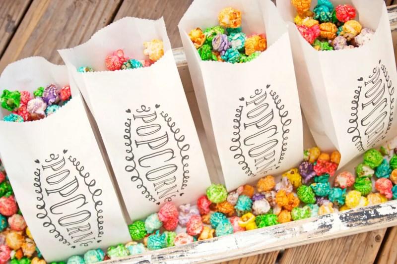 Colorful Popcorn Wedding Favor Bags by Mavora Art and Design | via http://emmalinebride.com/planning/popcorn-favor-weddings/ popcorn favor weddings