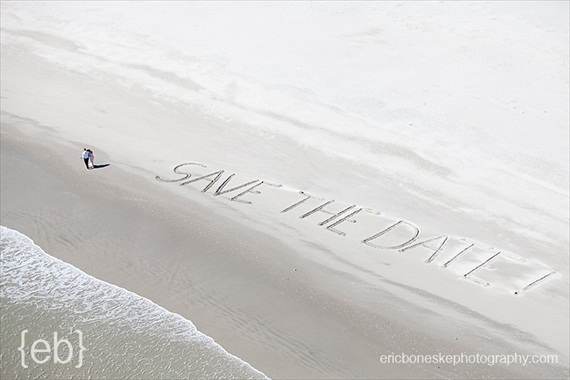 20 Best Engagement Photo Ideas: The Ocean + Save the Date Written in the Sand (by Eric Boneske)