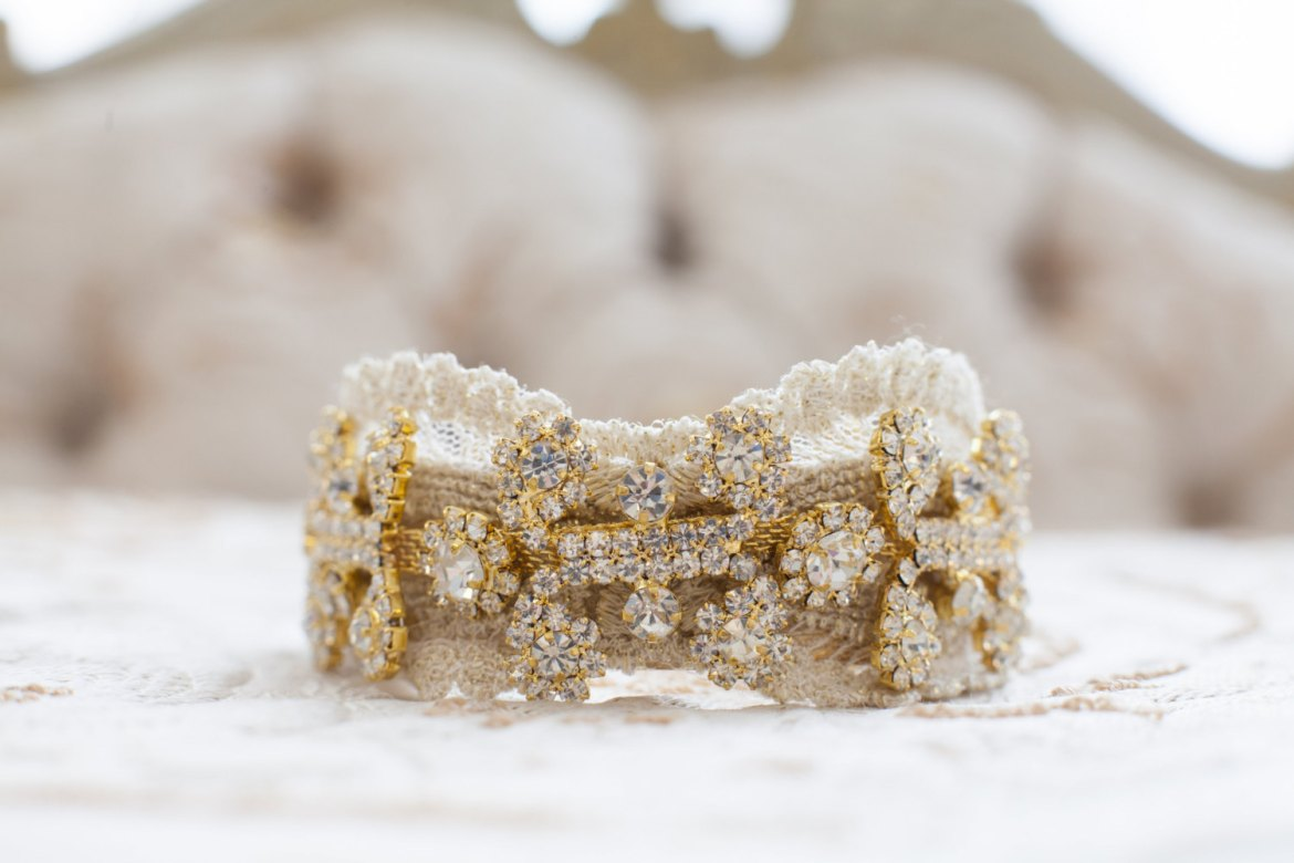 gold and rhinestone wedding cuff by cloe noel, photo by la candella weddings
