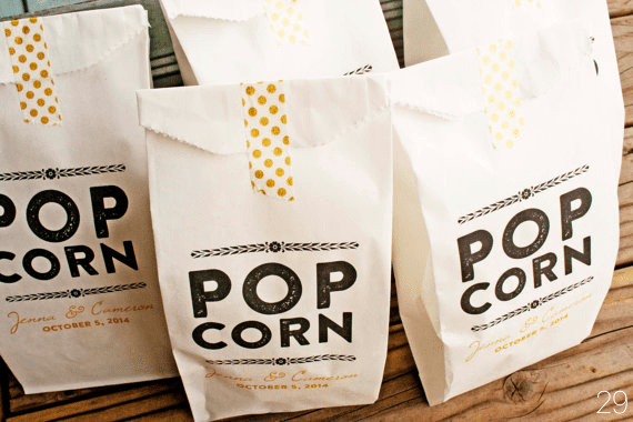 gold foil popcorn bags via 30 Best Gold Foil Ideas for Weddings