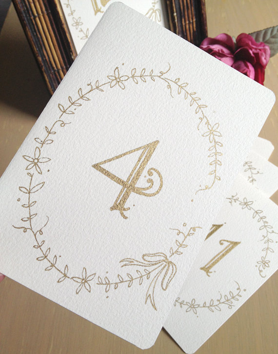 Cream and Gold Wedding Ideas: gold table numbers (by hmacdo studio)