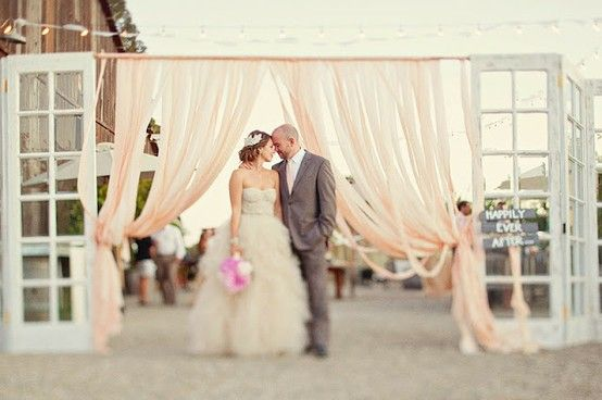 wedding ceremony backdrop with doors | via Ceremony Backdrops Doors | photo: Ellie Grover