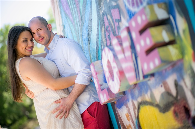 couple embraces by love sign at their Fun Austin Engagement Session | Photographer: Adrianne Riley Photography | via http://emmalinebride.com/real-weddings/fun-austin-engagement-session-priscella-jerry/