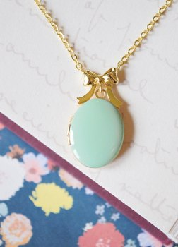 mint and gold locket with gold bow