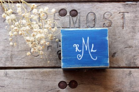blue ring box with monogram on top | via Rustic Ring Pillows http://emmalinebride.com/ceremony/rustic-ring-pillows/