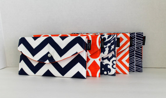 Orange and Navy Mismatched Clutches - pick a purse each bridesmaid will love in a particular color with her own unique pattern or print.