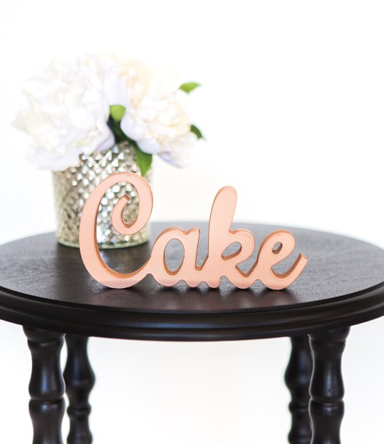 rose gold wedding cake sign