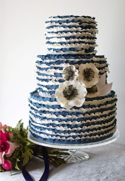 ruffled blue wedding cake with anemone flowers