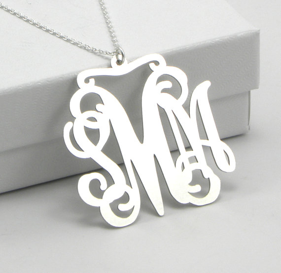 wedding trend: great idea! put on the monogram ring after the ceremony to officially 'announce' your new initials (via Monogram Necklace for Weddings from Emmaline Bride)