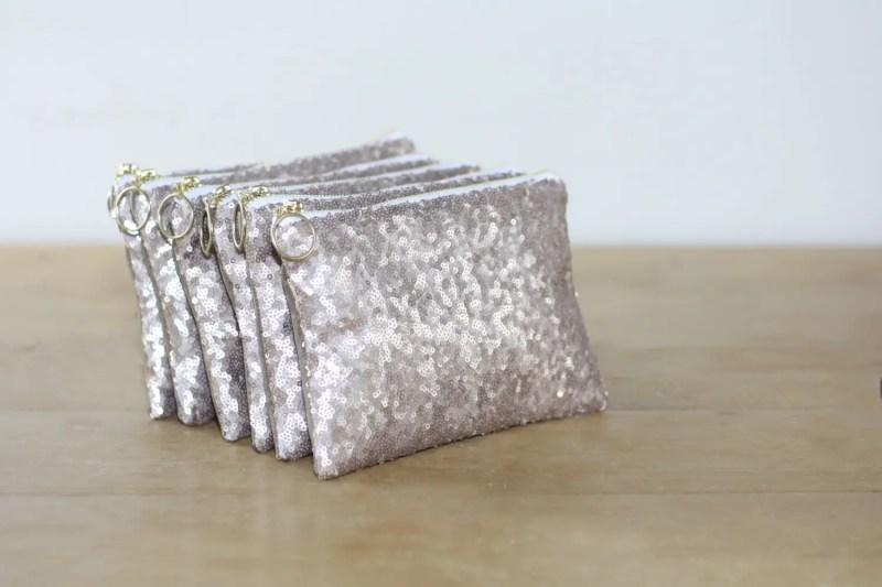 silver sequin clutch purse | http://emmalinebride.com/bride/sequin-wedding-dresses/