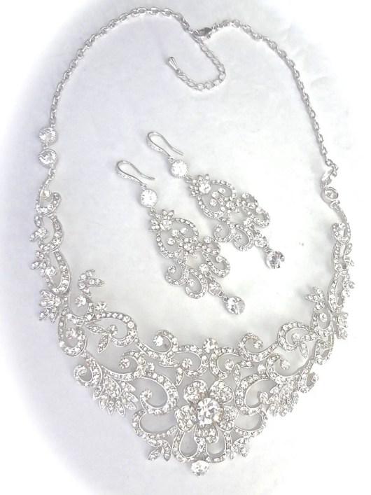 statement necklace   via Wedding Dress with Statement Necklace http://emmalinebride.com/bridal/wedding-dress-with-statement-necklace/