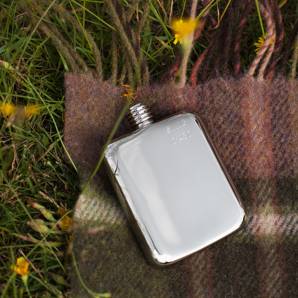 swig flask on plaid blanket | groomsmen flasks | http://emmalinebride.com/groomsmen/groomsmen-flasks-swig/