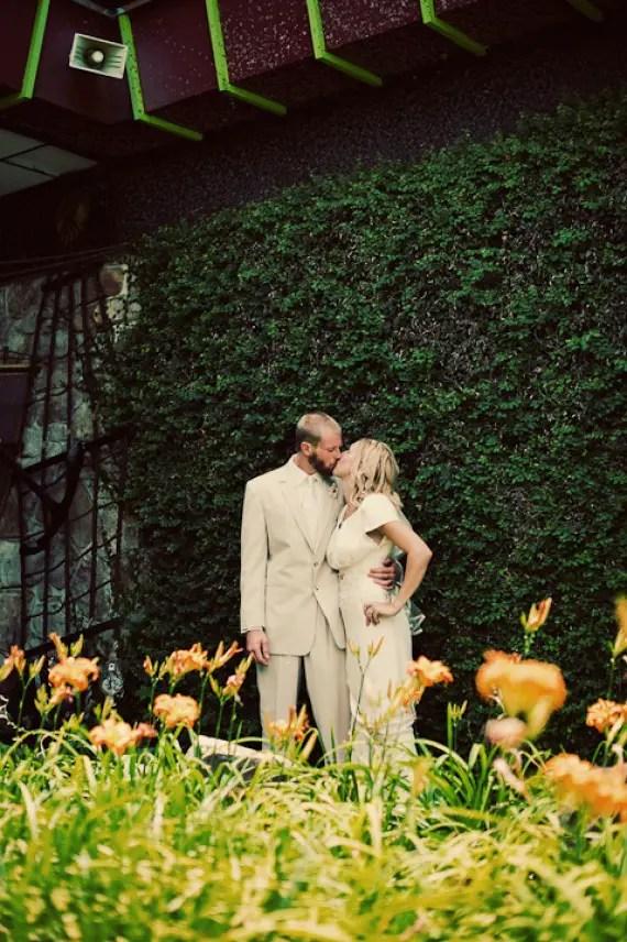 tuscaloosa-wedding-bride-groom-kissing-mossy-green-wall-backdrop