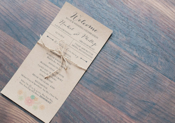 wedding program wrapped in jute twine | 35 Easily Beautiful Ways to Use Burlap for Weddings http://emmalinebride.com/rustic/ways-use-burlap-weddings/