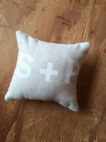 white text ring bearer pillow with initials