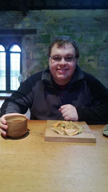 Cameron eating his Monk's meal at Fountains Abbey