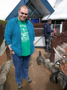 Cameron with the penguins at the Sea Life Centre in Scarborough