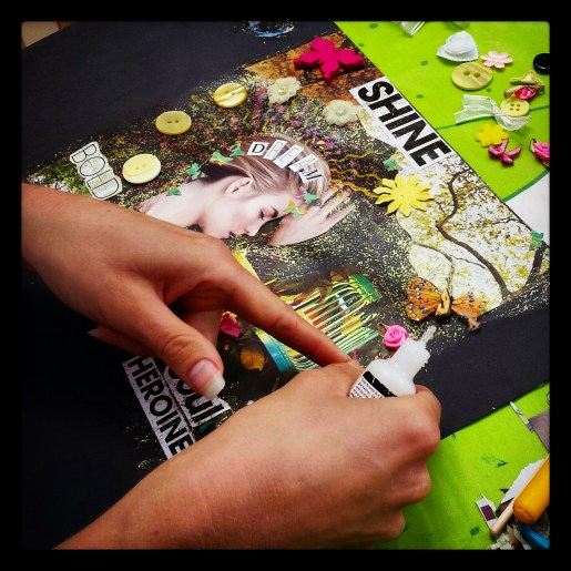 A workshop attendee collaging away!