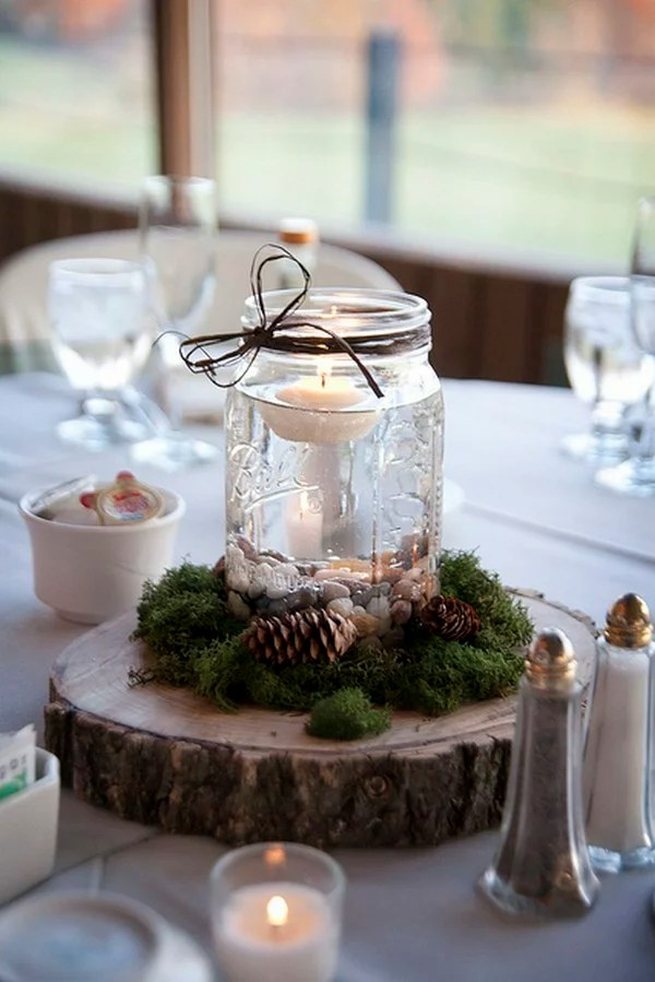 A Beautiful Collection Of Wedding Centepieces With Mason Jars