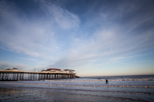 Cromer Pier and morning surfers