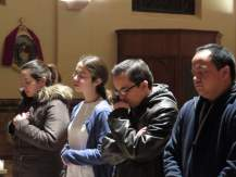 Young people adore the Blessed Sacrament.