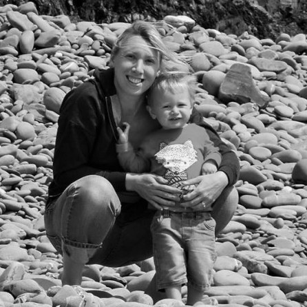 black and white photo of me and Jake on a stoney beach