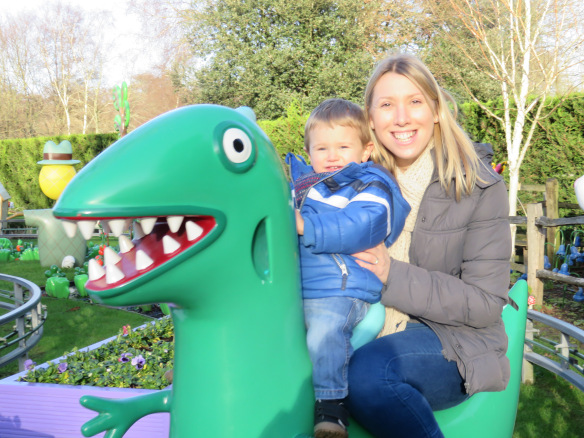 me and Jake on the dinosaur ride at Peppa pig world