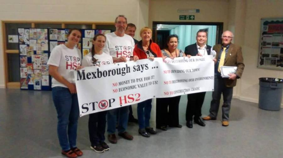 team holding up a banner against the HS2 trainline