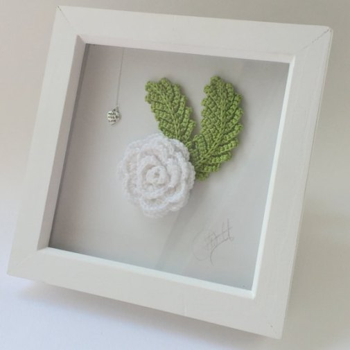 crochet peony in a white frame