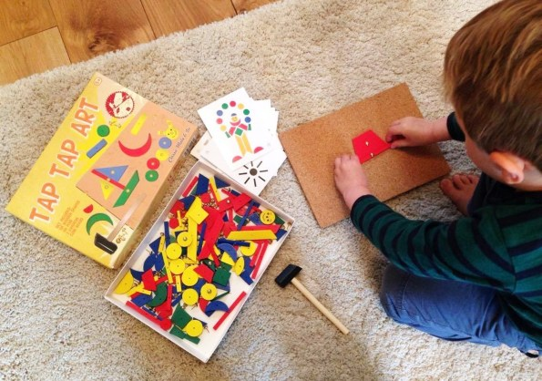 child using tap tap art