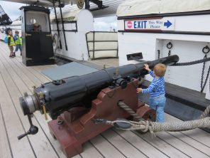 boy with canon on the ship