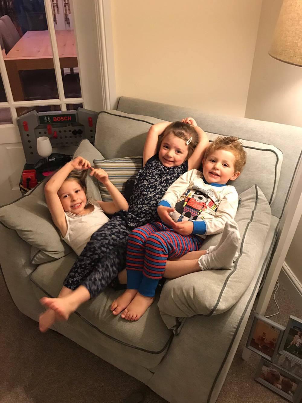 3 children sat on a chair