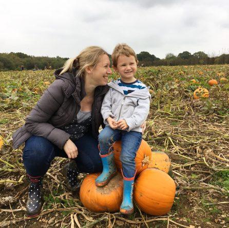 mum and child on pumpkins
