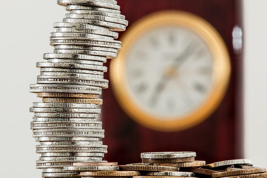 haggling and saving money- piles of coins