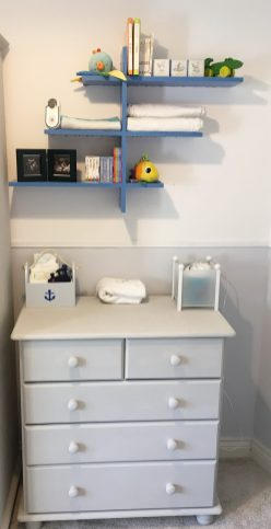 chest of drawers with a bookcase on the wall above