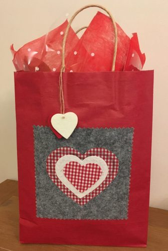 red bag with heart detail