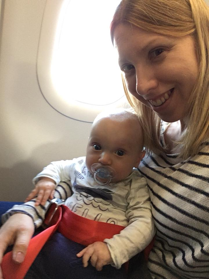 Mum flying with a baby on her lap