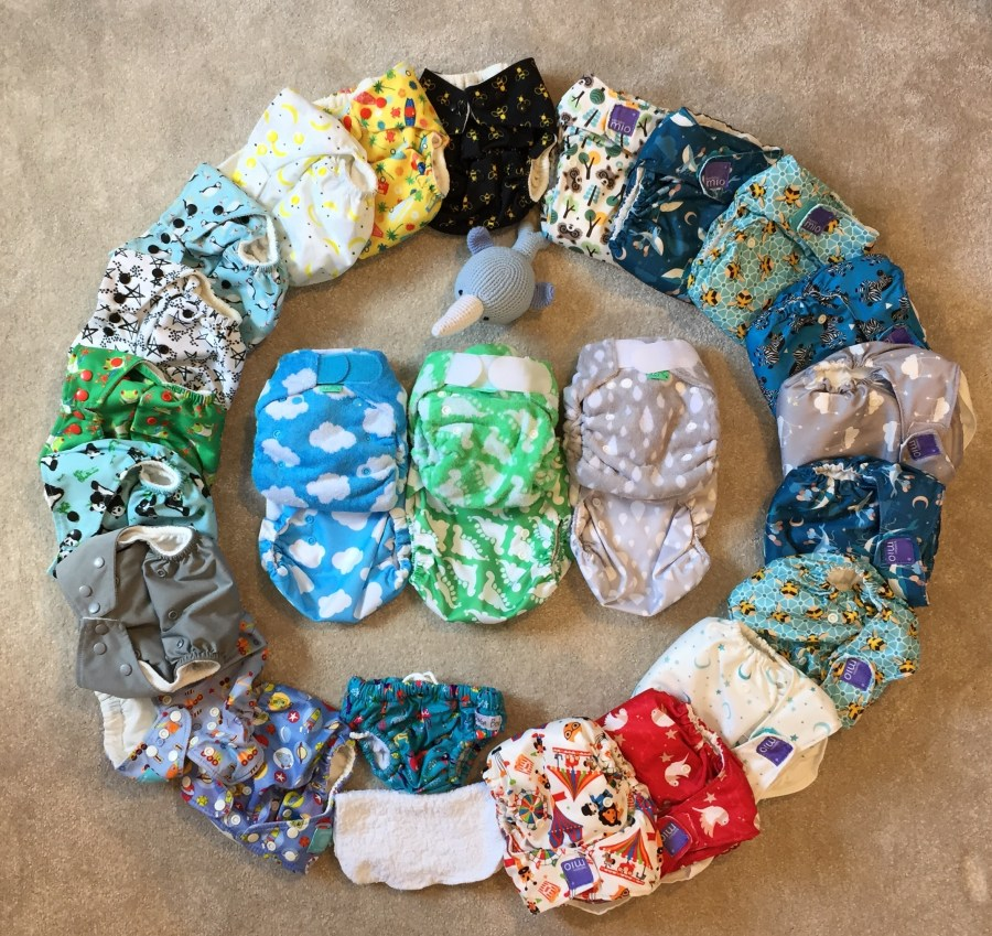 eco-friendly reusable nappies in a circle on the floor