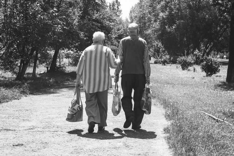 2 elderly people walking