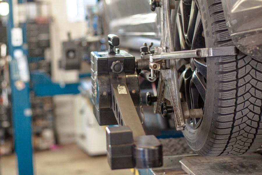 car in workshop having tyres aligned