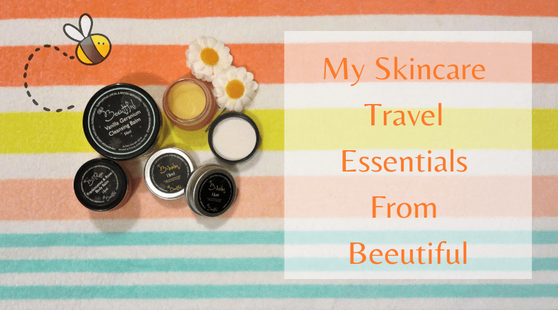 a ohoto of a flat lay of skincare products from Beeutiful on a striped beach towel